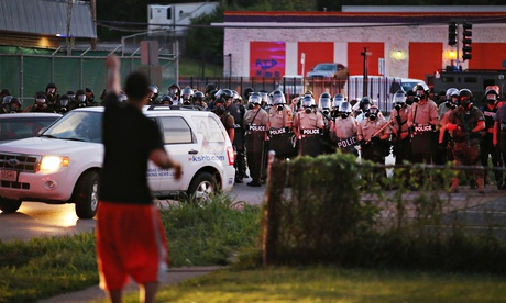 Police force protesters from the business district in Ferguson, Missouri