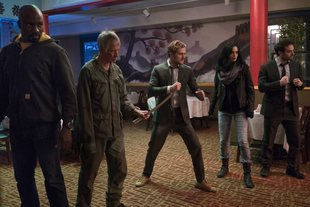 The Defenders fight in a restaurant